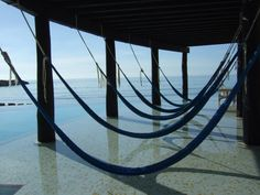 Hammocks over the infinity pool at #NowResorts Jade in the Riviera Maya overlooking the Gulf of Mexico