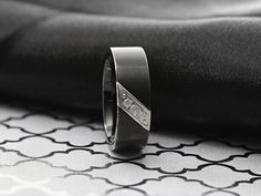 Designed for the gentleman, the LIAM ring. This band is designed with a beautiful black satin finish and will allow him to feel his best! Get 20% off with code LIAM20. Triton Rings, Tungsten Jewelry, Tungsten Carbide Wedding Bands, Engraved Rings, Black Flats, Black Satin, Satin Finish, Ring Designs, Gentleman