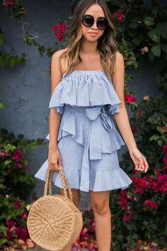 striped ots dress and straw bag