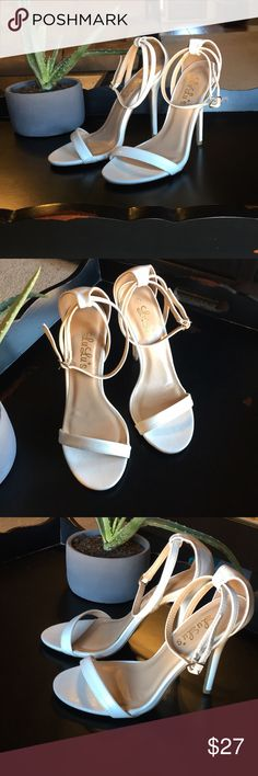 Gorgeous white heels NWOT. Never worn. Beautiful white stilettos in perfect condition! Can be worn with so many colors and dress styles! Lulu's Shoes Heels
