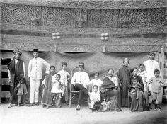 Toba Batak head with his family in their home, North Sumatra (c. 1900) - Tropenmuseum