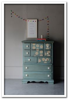 Love the colors of this dresser with the cream circular details.