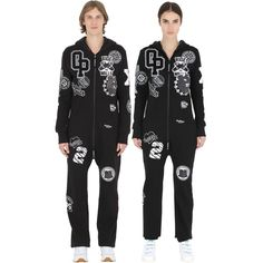 Onepiece Women Patch Cotton Blend Jumpsuit ($260) ❤ liked on Polyvore featuring jumpsuits, black, long sleeve jumpsuit, long sleeve jump suit, jump suit and onepiece jumpsuit