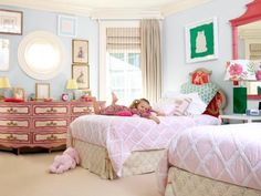 The dresser, which Ramey found at a vintage shop in Florida, got the pink ball rolling. The headboards were a garage sale find that Ramey's mother, an artist, painted with a monkey pattern.