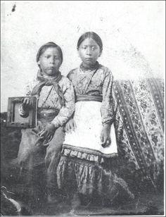 Unidentified boy, Martha Myrtle Angel (later aka Martha Myrtle Angel-McCoy) - Quapaw - 1875