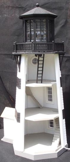 Just because Lynda loves lighthouses... They have a dollhouse... Why not combine?