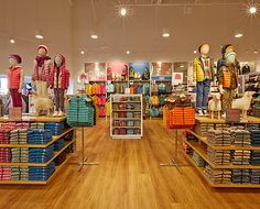 Stores Store locations westfield-trumbull-mall | UNIQLO Fashion Retail Interior, Clothing Store Interior, Clothing Store Displays, Clothing Store Design, Baby Store Display, Gift Shop Displays, Store Plan, Baby Clothes Storage, Visual Merchandising Displays