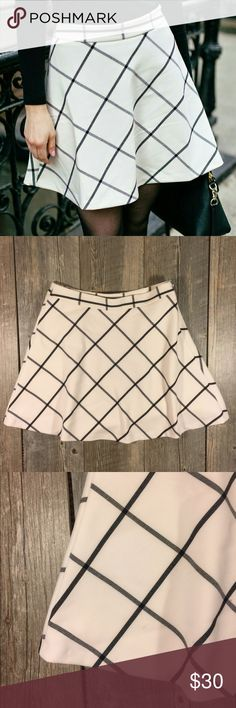 Loft white and black plaid skater skirt Loft white and black plaid skater skirt. Zipper on the side. Approx 19 inches long. Waist is approx 32 inches. Slip attached. Polyester rayon 4% spandex. Tag reads size 6 LOFT Skirts Circle & Skater