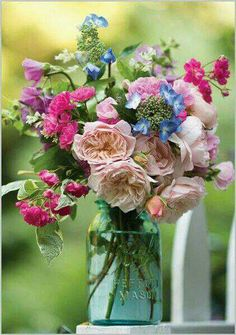 I love all the different colors and the different kinds of flowers in this arrangement.