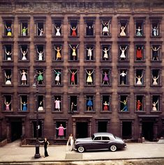 "Girls in the Windows, 1960.  From 'Girls in the Windows: And Other Stories by Ormond Gigli': ""...He was living on East 58th Street, in a brownstone that he bought with his earnings as a freelance photographer — take a deep breath, the dizziness will pass — and developers were razing the brownstones across the street to make room for a modern building. Mr. Gigli saw a grid of windows — 40 stages on which to mount a drama of creation and destruction in the big city...."""