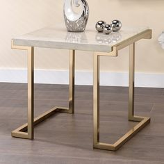 Bring modern glamour to your room's design with the ACME Boice II End Table . This contemporary end table boasts a faux marble top and a champagne-finished,. Acme Furniture, Steel Furniture, Home Decor Furniture, Furniture Design, Contemporary End Tables, Global Home, Coffee Table Design, Engineered Wood, Living Room Designs