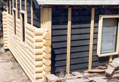 Heck with paint, let's do a real makeover!! Log siding with Timberline log corners.