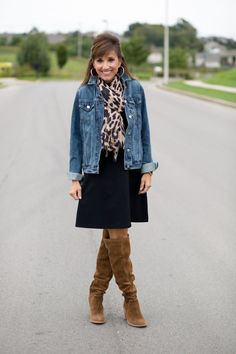 To style this sleeveless black dress for fall, I added a leopard print scarf and over the knee boots plus a denim jacket for the cool weather.