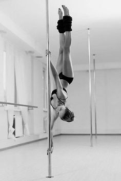 This isn't being a stripper. She's supporting her entire body upside down with her arms! This is fitness and exercise and I wish it wasn't looked down upon as something so negative all the time. I wish I could do that, no scratch that, I WILL do that.