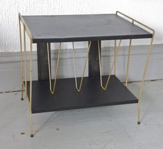Mid Century side table / book rack $115 - Chicago http://furnishly.com/catalog/product/view/id/490/s/mid-century-side-table-book-rack/