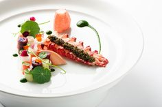 The Mandarin Grill's 'LOBSTER' dish is a magical collection of colours and ingredients - Buttered poached lobster from Brittany meets caviar, seasonal vegetables are rolled like ribbons and this dish is completed with a Lobster consumme to strengthen the taste. Does this dish excite your taste buds?