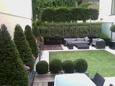 Project under £100k - Roof garden to Belgravia apartment including GRP planters artificial lawn, limestone paving, Iroko hardwood decking irrigation, planting and lighting