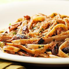 Even sardine skeptics will enjoy this lemony pasta with crispy breadcrumbs. Substitute two 5- to 6-ounce cans chunk light tuna for the sardines if you prefer. If you are using tuna or can't find sardines packed in tomato sauce, add 2 tablespoons tomato paste in Step 4 with the lemon juice. Serve with a salad of bitter greens tossed with a lemon vinaigrette and a glass of Pinot Grigio.