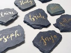 DESCRIPTION: naturally shaped slate stone escorts with hand lettered calligraphy These beautiful slate place card tiles with handwritten calligraphy can double as fabulous wedding or party favors for your guest to bring home. DETAILS: • These slate tiles are pieces of natural Vermont slate. • Sizes, shapes may vary slightly averaging 2-3 in diameter. • Color will vary in each piece ranging from a grey-green to grey-blue to grey-black to grey-purple. If you have a specific color request…