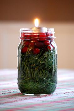 It doesn't get any simpler! ~mason jar, greenery, cranberries, water, tea light~ simple Christmas table centerpiece done! :-)