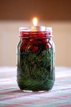 Mason jar, greenery, cranberries, water, tea light