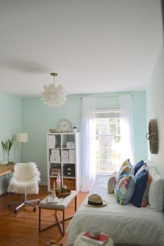 Freshen up your work space. Beth from designPOST interiors makes over this office with help from a soft aqua wall color.