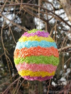 """I remember learning to make piñata's in grade school and thought it would be a fun addition to our family's annual Easter get together. While very patiently watching it dry,my son Corey has asked, """"Can I hit the piñata now?"""", at least30 times .This is one egg that every kid would love to crack open! …"""