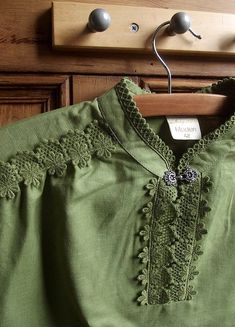 Green Blouse with Floral Trim Lace at Neck on a Wooden Hanger ....