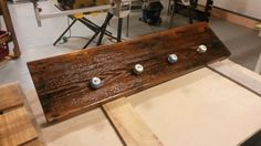 Coat rack built from a reclaimed stair tread board and some cabinet knobs