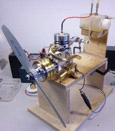 A small four-stroke engine with sleeve valve control ready to start