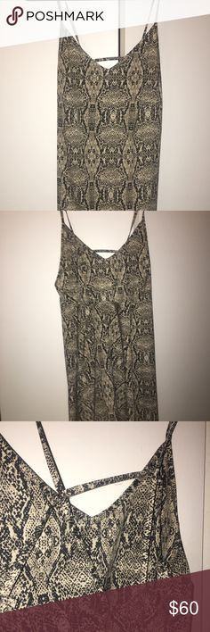 LF Snake Skin Open Back Shift Dress LF Snake Skin Open Back Shift Dress - super cute and only worn once so in perfect condition. Open back is super flattering and sexy! Material is soft and perfect to wear with a leather jacket or no jacket in the summertime! LF Dresses Mini