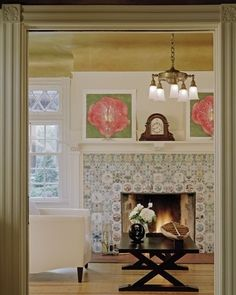 Love the hand painted tiles on this beautiful fireplace.