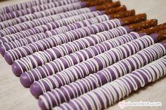chocolate-covered pretzel rods: purple coating + white chocolate swirl
