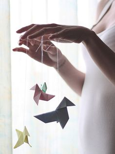 paper cranes - this would be so cool to hang from a ceiling ... Hmmm, I dont remember how to make paper cranes.