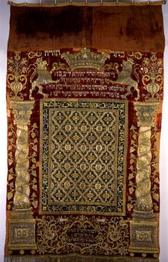 A German Torah ark curtain (parokhet), 1723-24, made by Elkana Schatz of Fürth; embroidered motifs include rampant lions supporting a crown, symbolically referring to the lion of Judah and the three crowns symbolising Torah, priesthood and royalty. (The Israel Museum)