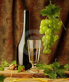 Still life with wine and hanging grape by Michaela Stejskalova, via Dreamstime