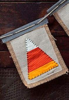 Create this cute DIY Candy Corn Banner for Halloween out of burlap, muslin and a little spare fabric!