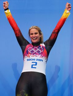 Gold medalist Natalie Geisenberger of Germany celebrates during the flower ceremony for the Women's Luge Singles (c) Getty Images Olympic Winners, Bobsleigh, Luge, Sporty Girls, World Of Sports, Winter Sports, Olympic Games, Olympics, Wetsuit
