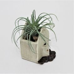 This Ceramic Succulent Planter is the perfect small planter for that empty spot in your kitchen, bedroom or bath.  I created this rustic planter from stoneware clay, and it features an open door and stone entry way.  The open door is simply an illusion, as this planter is completely sealed and read