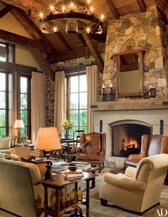 Interior designer Elissa Cullman used warm tones for the sophisticated but relaxed living room of a ranch house in Colorado ski country.