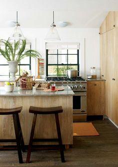 dark floor, white walls,gray countertop, white oak, clear light fixtures