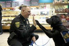 Dixon and Winters Police Chaplain Robert Duvall high-fives his partner Kepi. Duvall believes she is the first dog of her kind in the state working specifically on crisis intervention and compassion for law enforcement and first responders. Sally Schilling — The Reporter