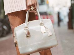 Adorable purse paired with gold accessories!