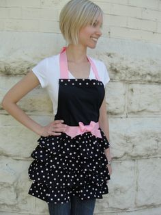 Black with soft pink polka dots/pink grograin ribbon trim. www.etsy.com/shop/overthetopaprons