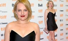 Elisabeth Moss sheds her good girl image to stun in a mini dress