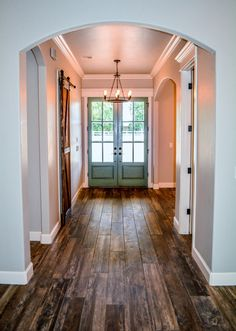 Hardwood hallways and colored doors