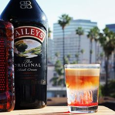JELLYFISH SHOT Creme de Cacao Amaretto Bailey's Irish Cream Grenadine #baileysirishcream #cocktail #jellyfish #drinkporn    Just made this and ran outside to take a pic before the sunset. You can see the Los Angeles palm tress in the background.