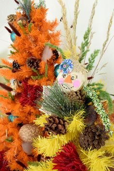 Orange and yellow fall trees with pinecones, acorns and scarecrows by Jennifer Perkins