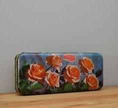 Vintage biscuit tin with orange roses by LostPropertyVintage, £10.00