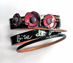 ife is made up of small pleasures . . . A set of four bangles,completely handcrafted and enameled in vivid shades - topped with poppy flowers